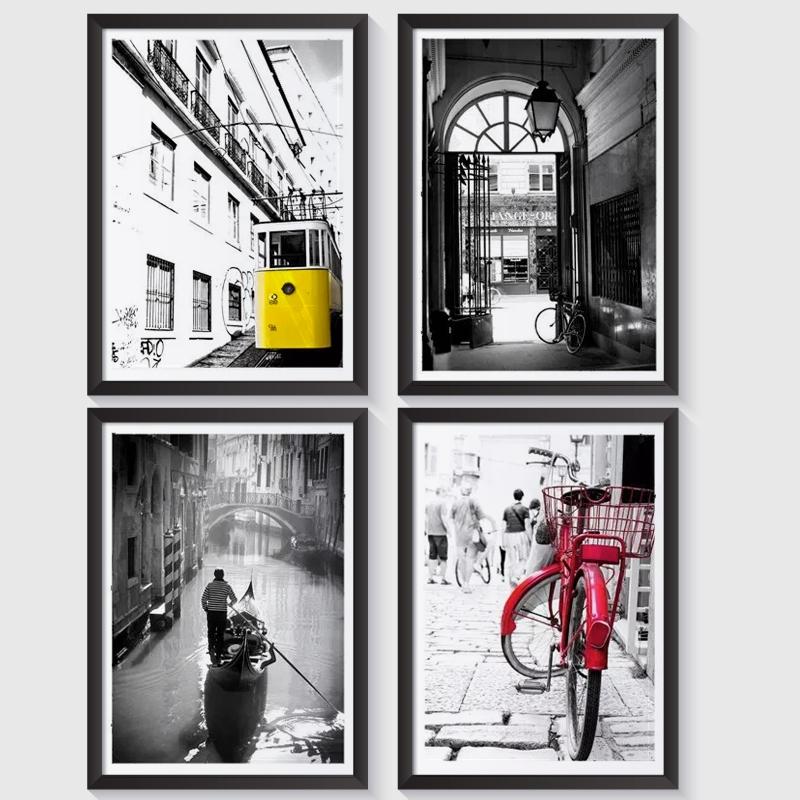 Zestaw 4 plakatów w ramach z serii MIASTA oprawionych w ramki. Lizbona, Paryż, Amsterdam, Wenecja. Plakaty w formacie A4 oprawione w ramki. Gotowe do zawieszenia na ścianę.